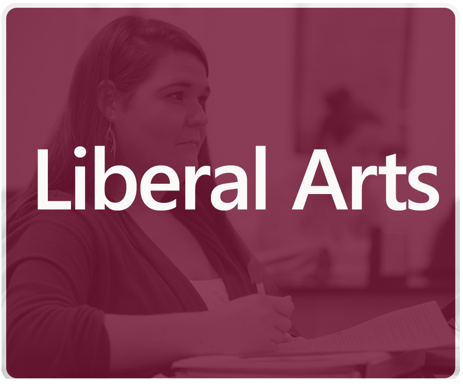 Liberal Arts major pathways. A female student takes notes in a seated class.