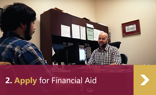 2. Apply for Financial Aid - male student talking to male financial aid advisor in office.