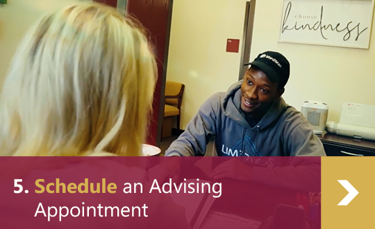 5. Schedule an Advising Appointment - Male student gets advice from female advisor in office.