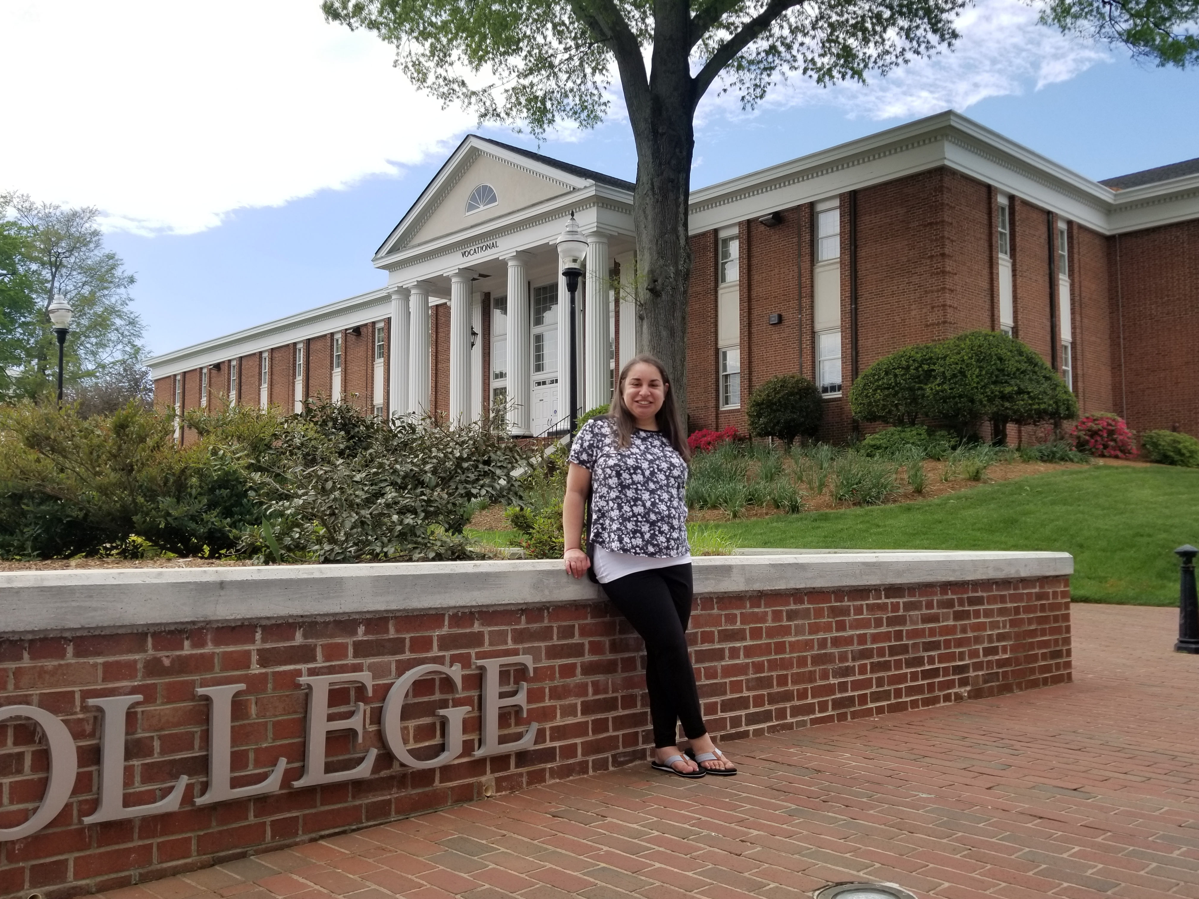 Lindsey Hebert shares a smile in front of Mitchell's Statesville Campus