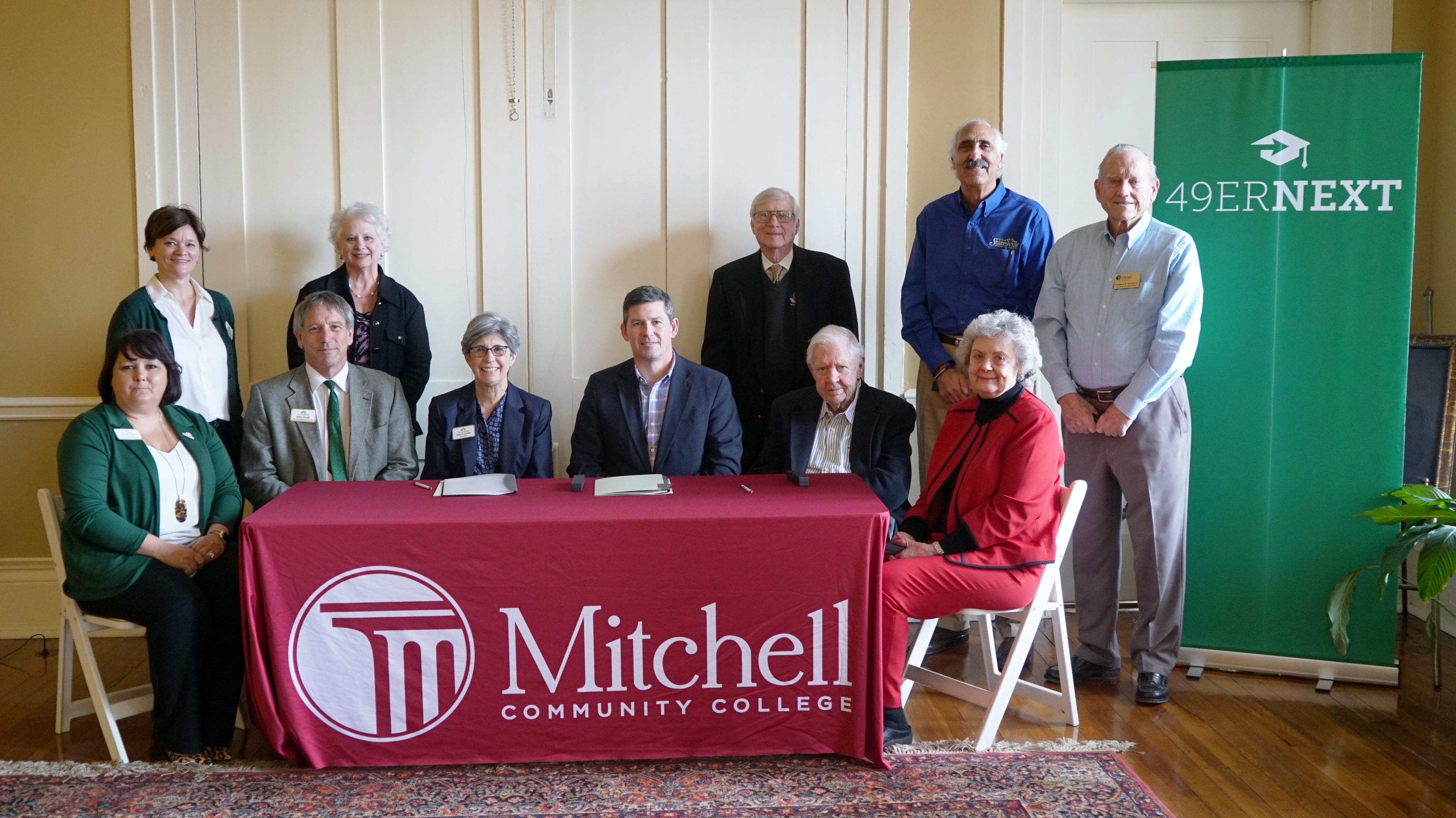 Mitchell and UNC Charlotte dignitaries at the formal program signing on March 12, 2020.