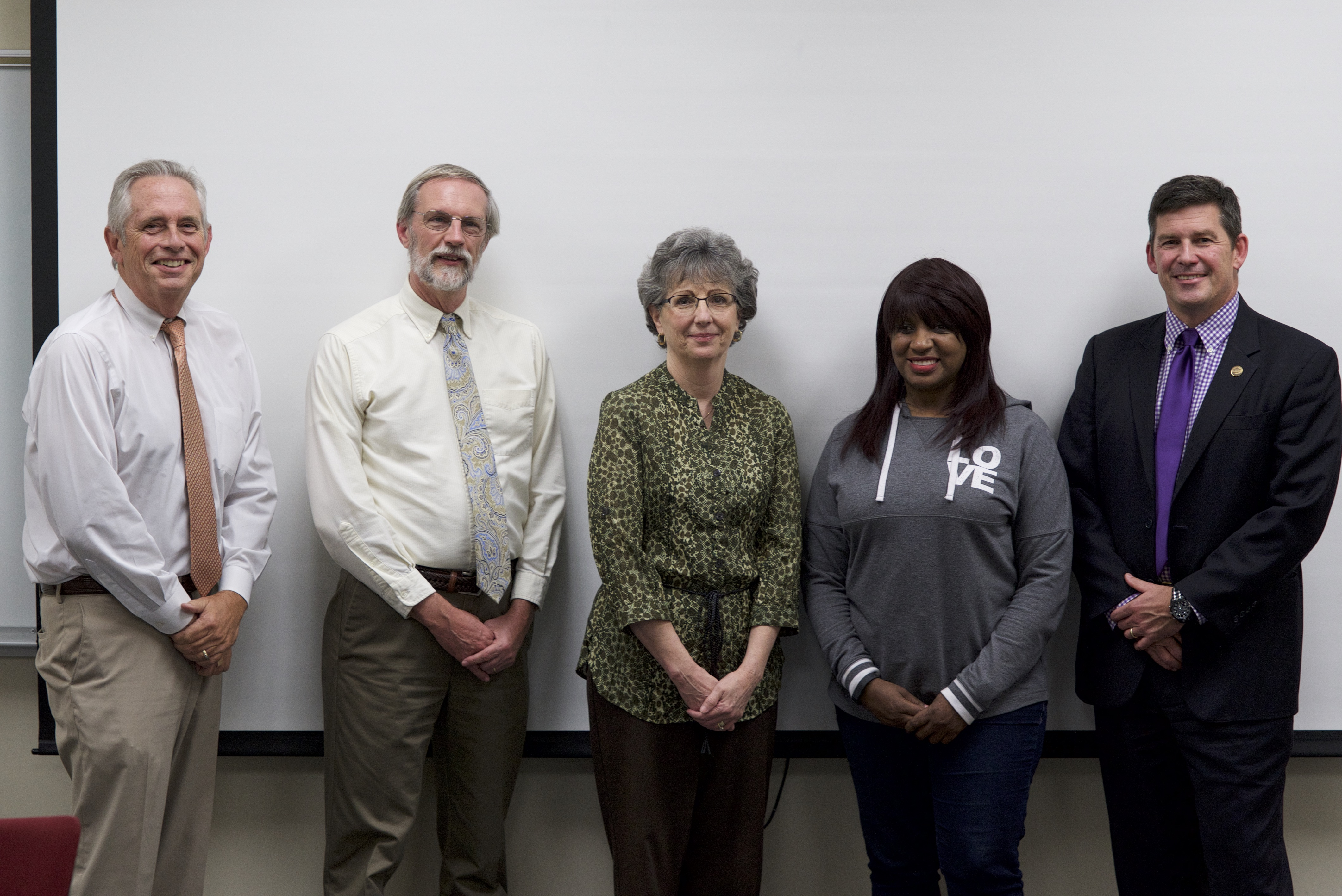 (L-R) Program dean Mark Smalley, instructor Phil Holleran, students Belinda Rumple and Thangee Griffin, and Mitchell president Tim Brewer