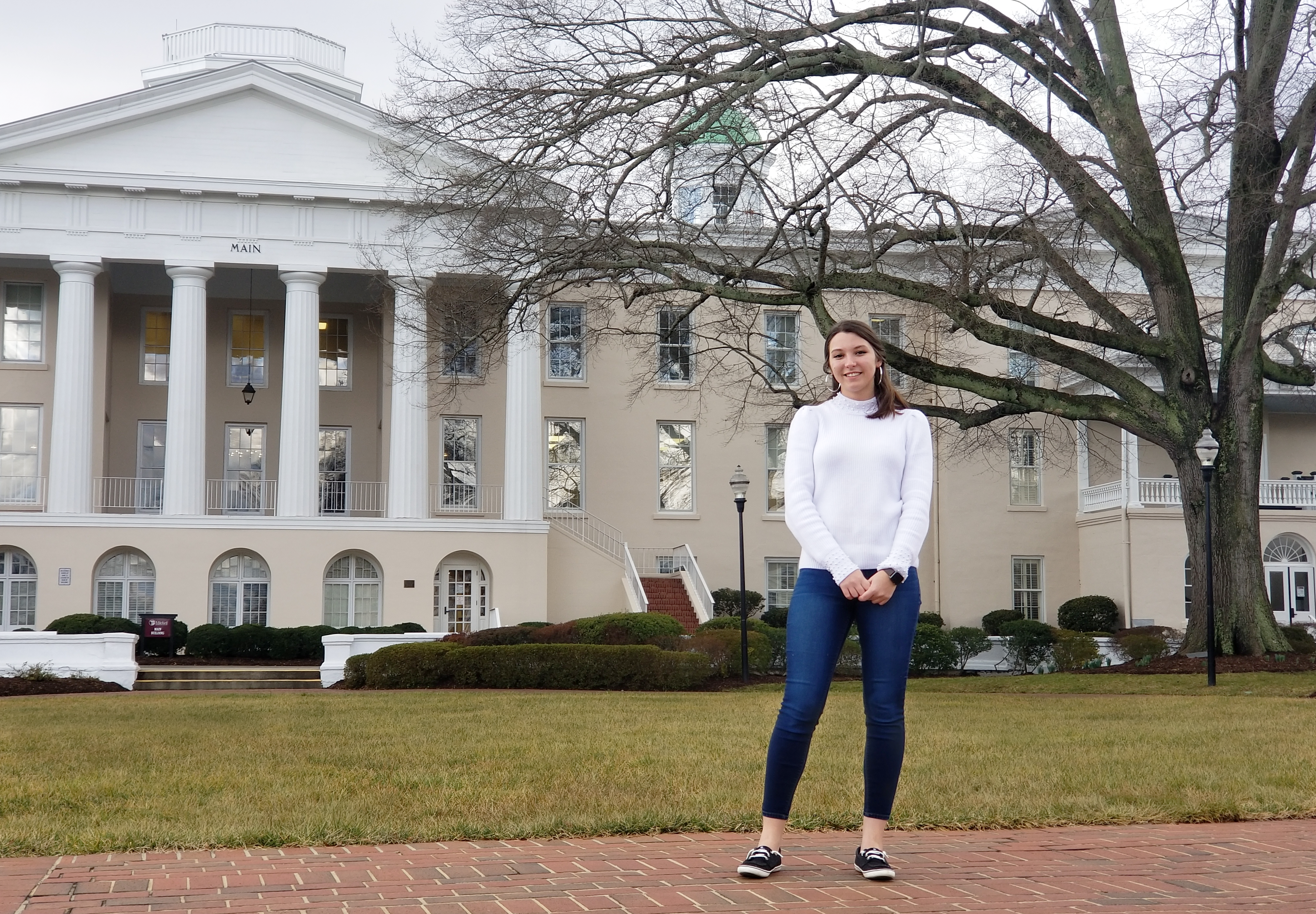 Brittany Welborn in front of Main Building on the historic Statesville Campus