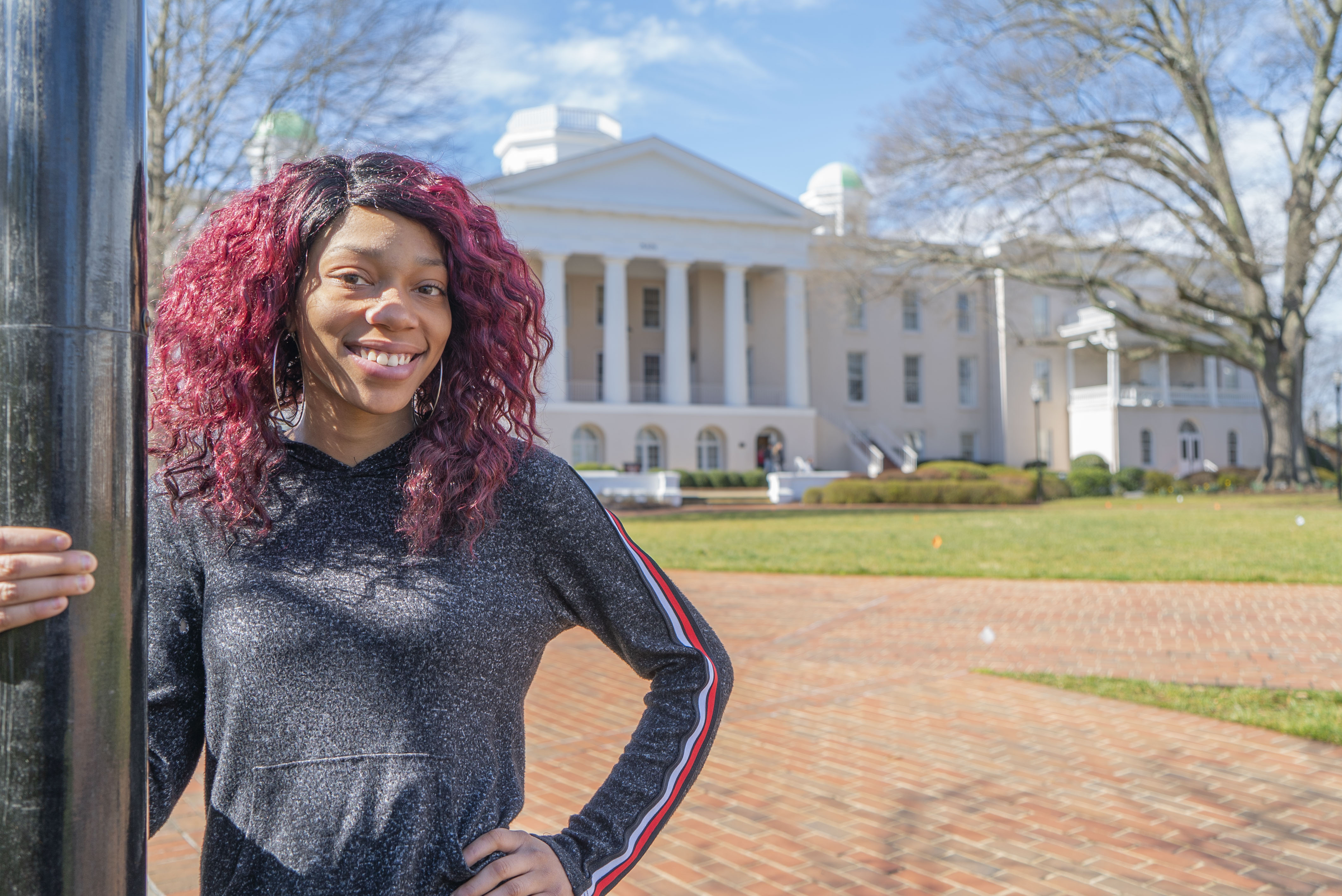 Ty'ana Ivory stands in front of Mitchell's Main Building.