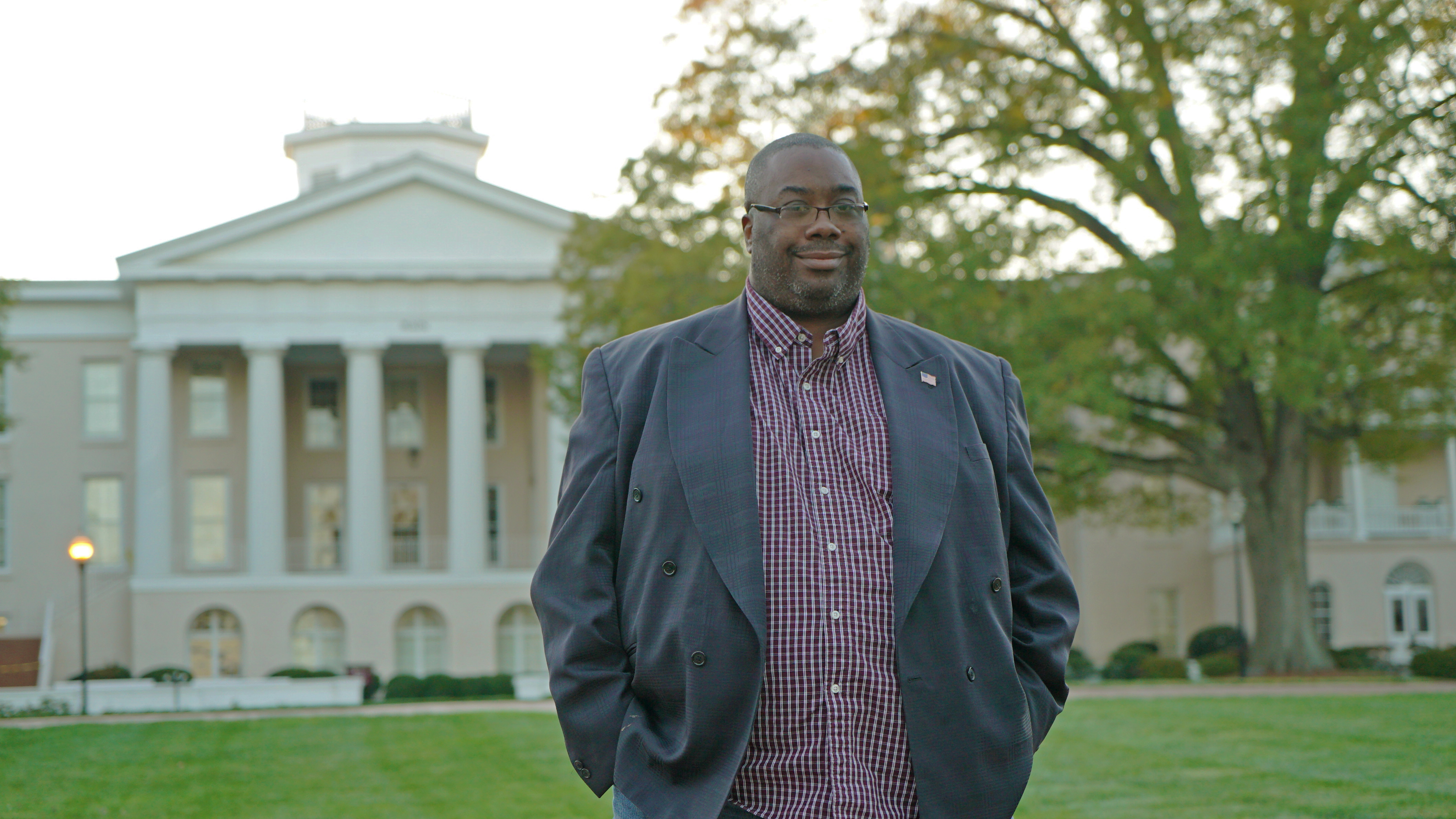 Frederick Foster stands in front of Main Building on Mitchell's Statesville Campus.