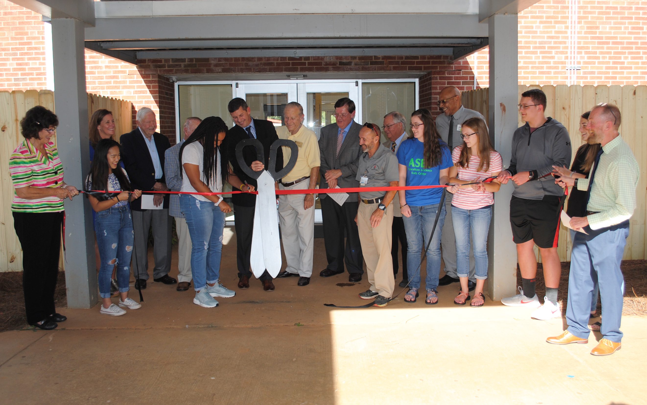 Officials from Mitchell Community College, Iredell-Statesville Schools, North Iredell High School (NIHS), the Agriculture & Science Early College (ASEC) faculty/staff and students along with representatives from local and state government celebrate the ribbon cutting of Mitchell's North Iredell Center.