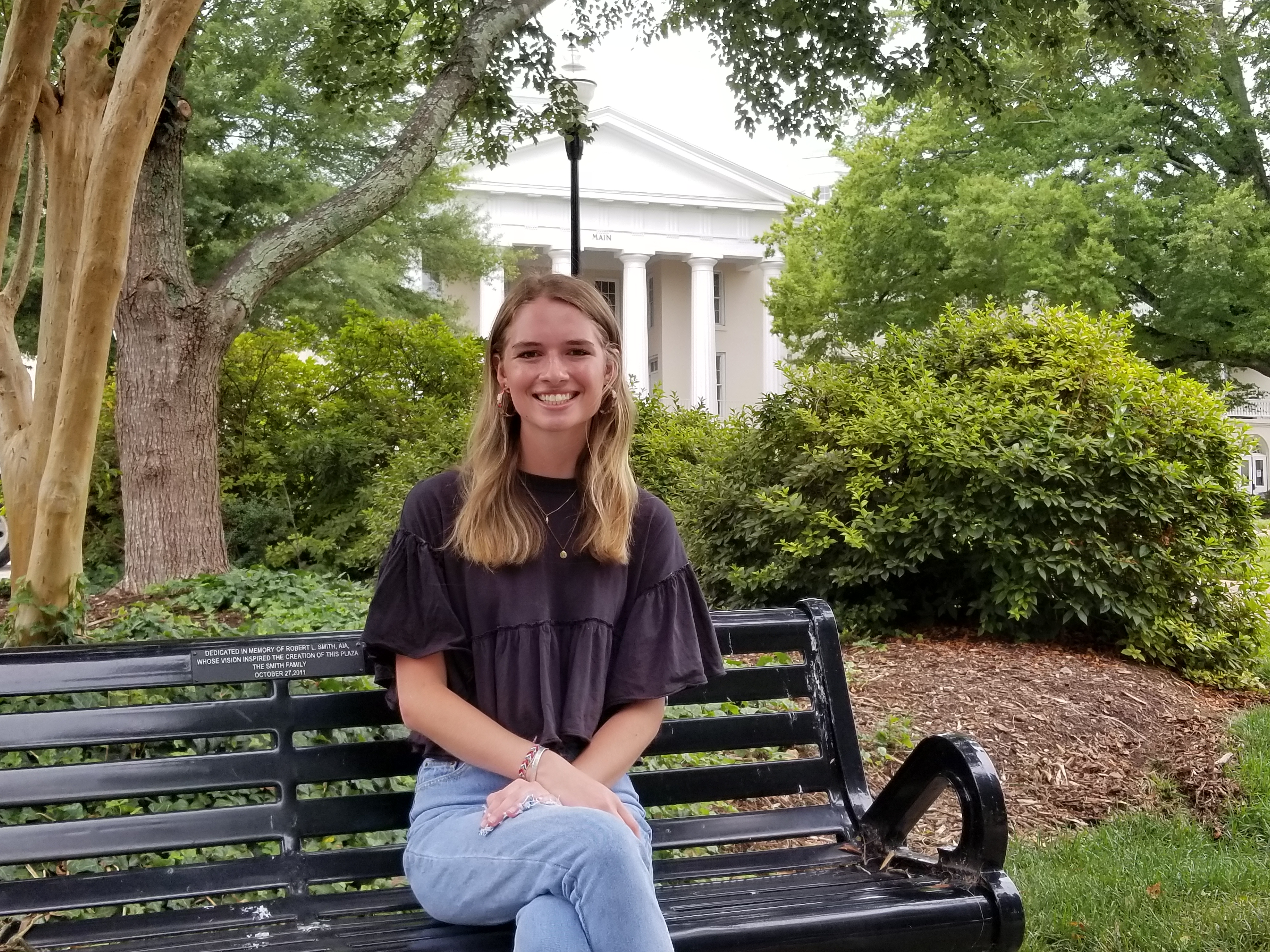 Genny Wooten sits in front of Main Building on Mitchell's historic Statesville Campus