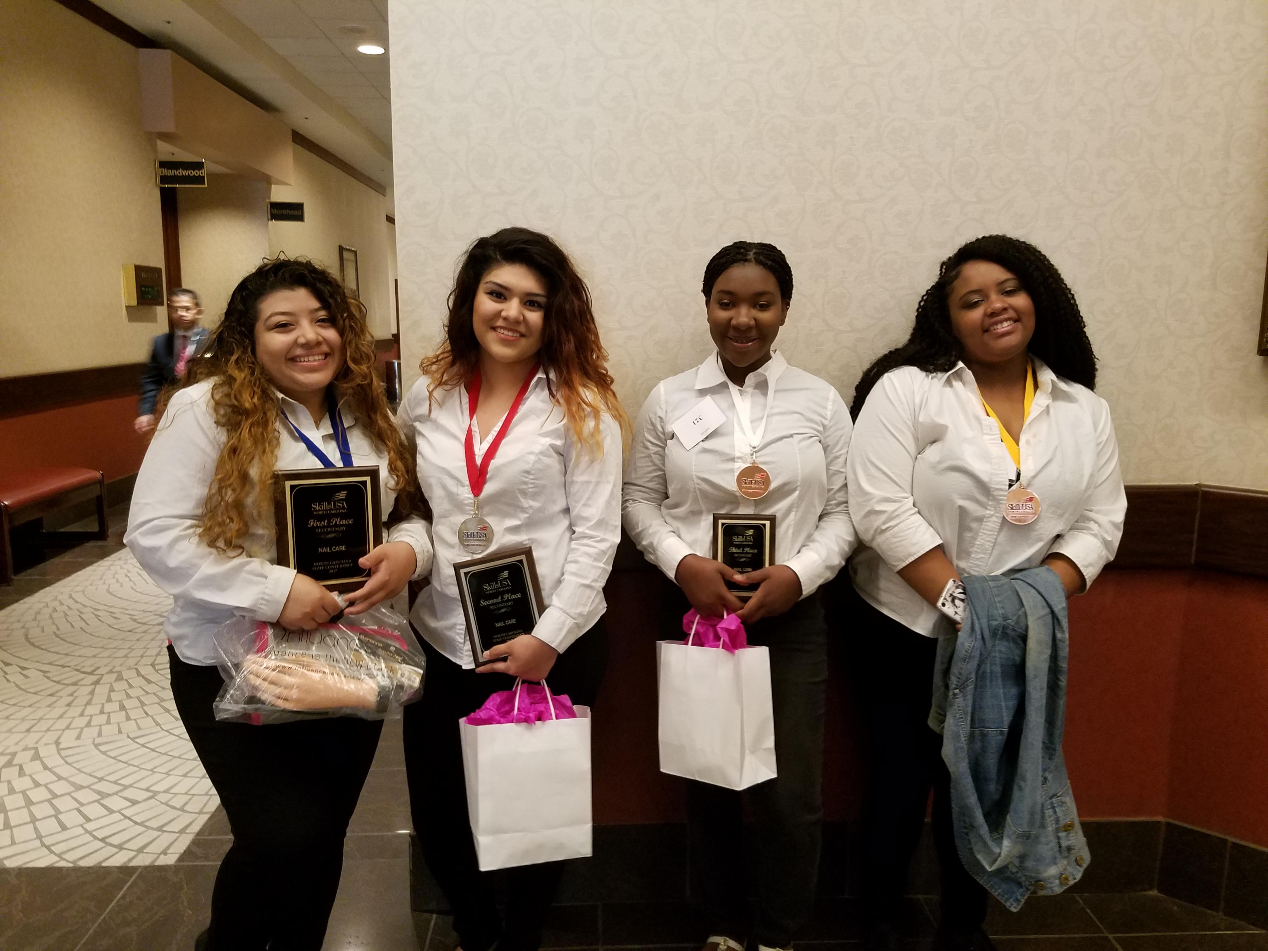 Nail care winners Jacquline Castaneda, Briceida Garcia, Leondria Turner, and Ayonna Miller