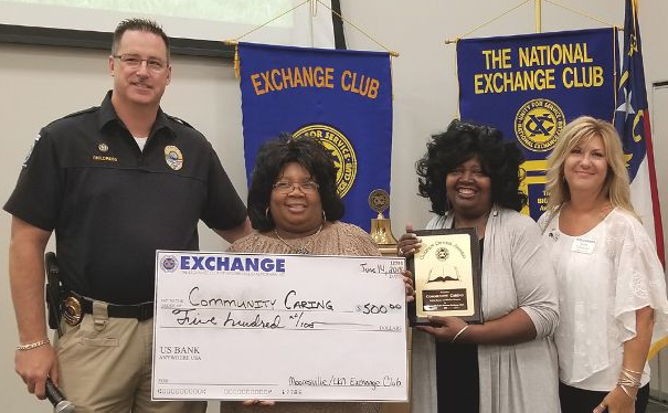 Robbie Turner and Merline Houston accept the Book of Golden Deeds award and check from Gerald Childress and Kim Saragoni, then president of the Mooresville-Lake Norman Exchange Club. Photo originally featured by the Mooresville Tribune on July, 10, 2018. Photo courtesy of Cotton Ketchie