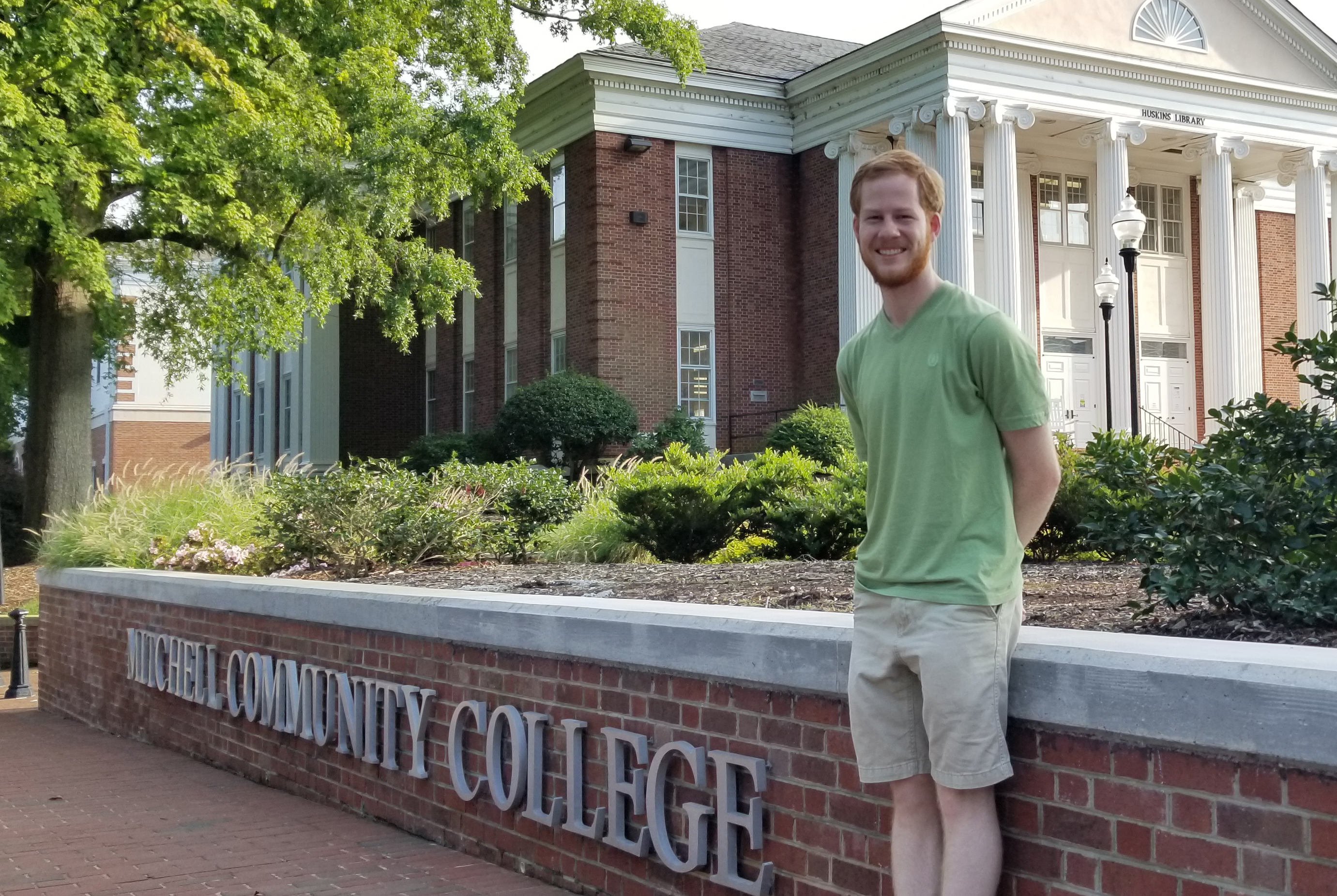 Will Thrailkill stands in front of Mitchell's historic Statesville campus