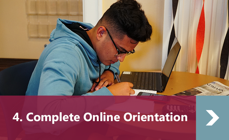 4. Complete Online Orientation Button. Student at library table doing math homework.