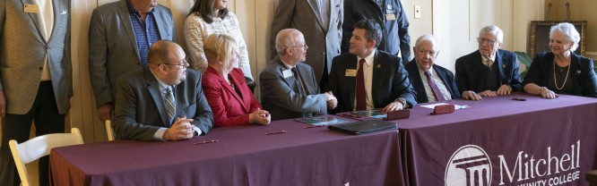 Dignitaries from Mitchell Community College and Gardner-Webb University (GWU) formally sign an articulation agreement for the associate in general education and select associate in applied science degrees.