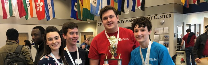 (Left to right) Makayla Warren, Coleson Elliott, Lee Cline and Erick Boniface pose with a trophy at the 2019 UNG Math Competition