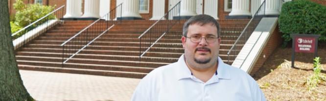 Jonathan Harris stands on Mitchell's Statesville Campus.