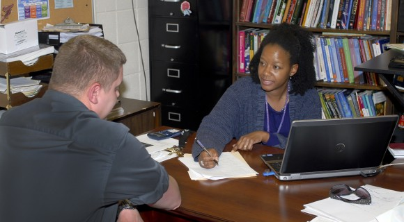 A student and an advisor discuss academic plans.