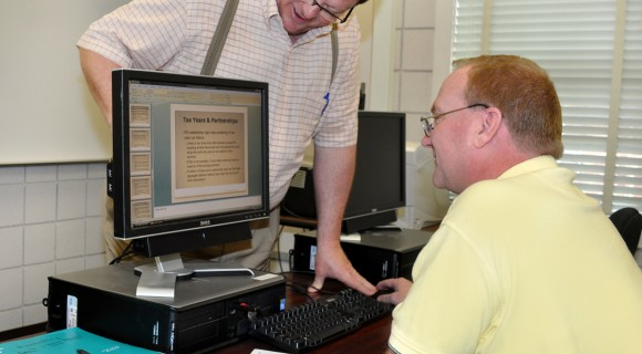 Accounting student gets some help from his instructor