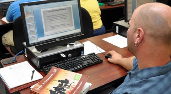 Student tackles an accounting assignment on the computer
