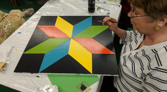 A student works on a quilt project.