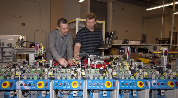 Workers calibrate equipment for a process