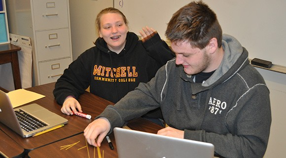CCTL students work on an assignment that utilizes uncooked spaghetti.
