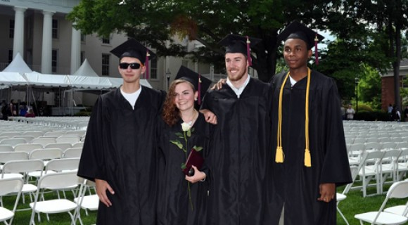 CCTL grads post for a picture at graduation.