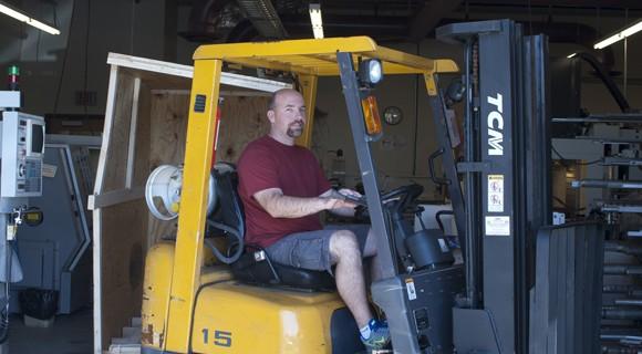 Forklift driver moves a pallet