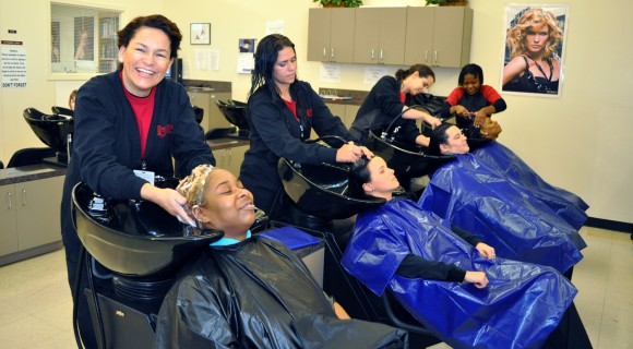 Cosmetology students shampoo their clients' hair.