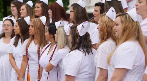 Nursing graduates pose for photo.