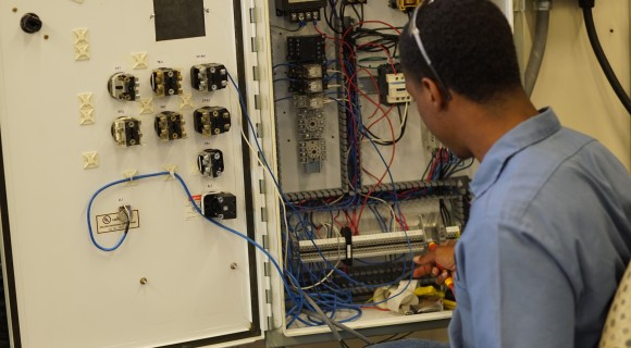 A student in the electronics lab.