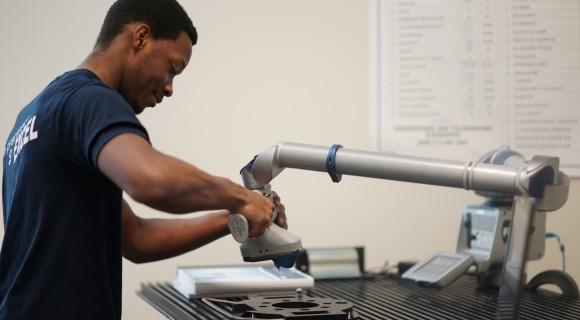 A student works with a scanning arm tool