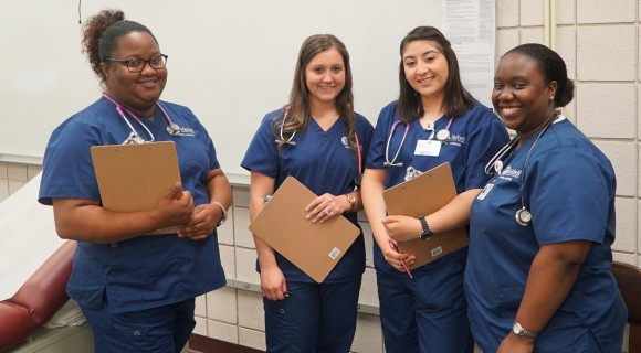Four students posing during class.