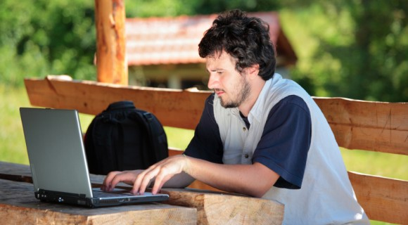 A student works on laptop