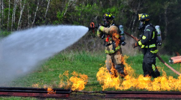 Firefighter douses wildfire
