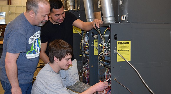 Instructor Bret Benton works with HVAC/R students Colton Lombardy and Saul Mayo Castro in the Mitchell HVAC lab.