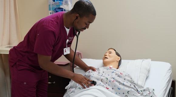 Nursing student in a simulation lab