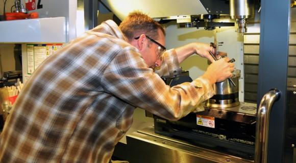A student adjusts industrial equipment