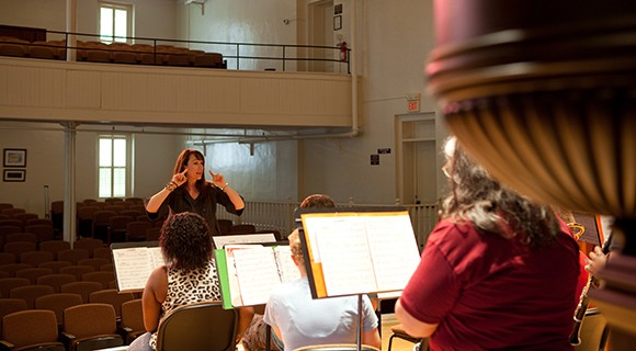 Music Instructor Beverly Brown directs in class.