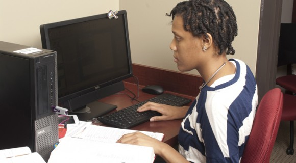 A student completes work at a computer