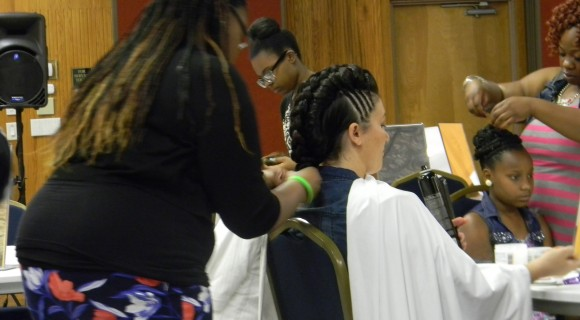 Cosmetic Student Putting in Weave