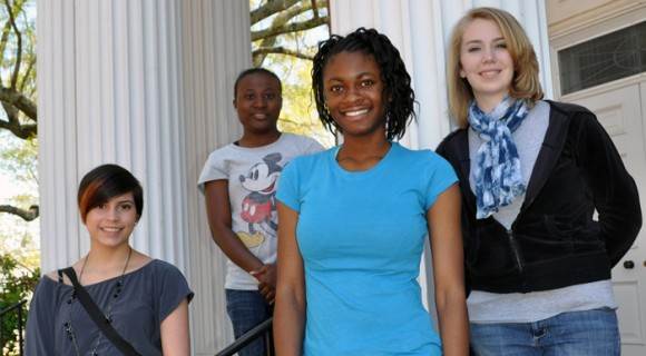 Students pose on the front steps for a photo