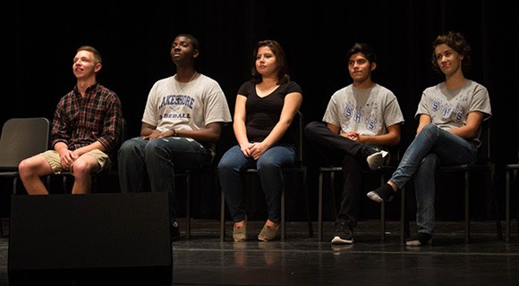 VPAC students sit on the stage.