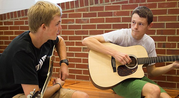 VPAC students play guitar together.