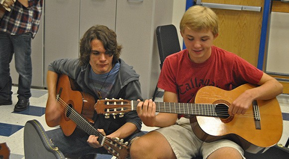 Two VPAC students play guitar.