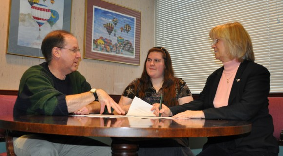 A student meets with College advisors to plan work-based learning.