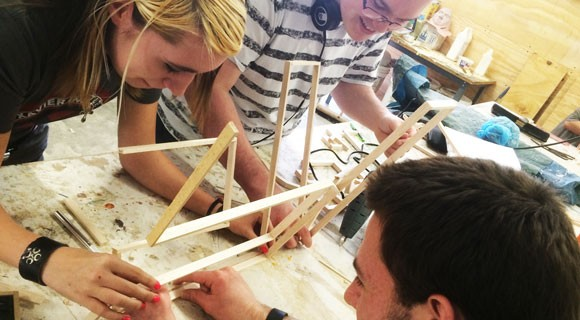 Students work together to build a wooden structure.  Mitchell Community College Art Department