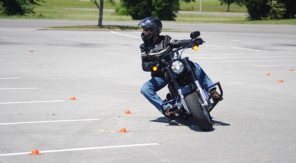 Motorcyclist rides the obstacle course.