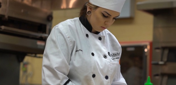 A culinary student prepares food.