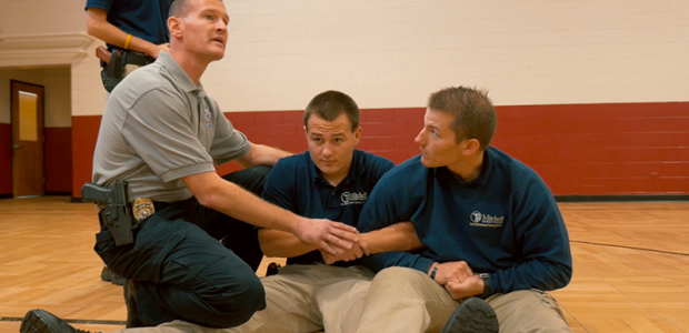 A BLET instructor works with two cadets