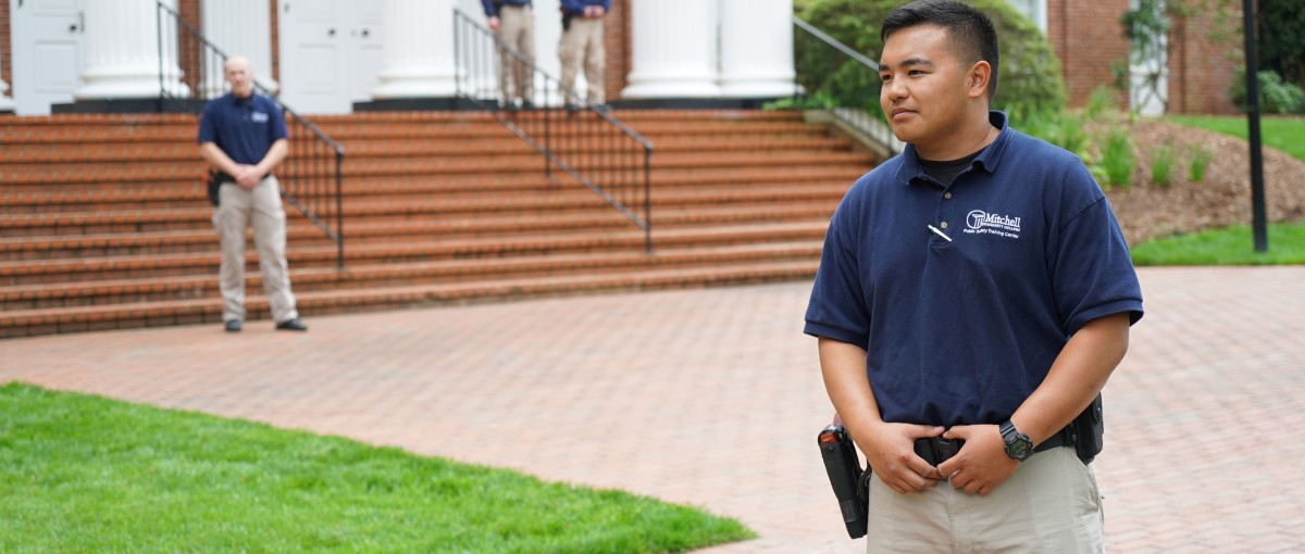 A BLET student stands in front of Statesville Campus with his peers.