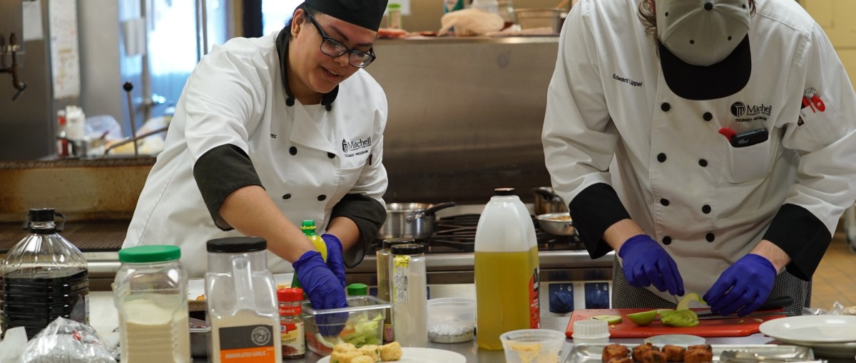 Culinary students preparing appetizers